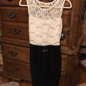 White, black and gold lace dress